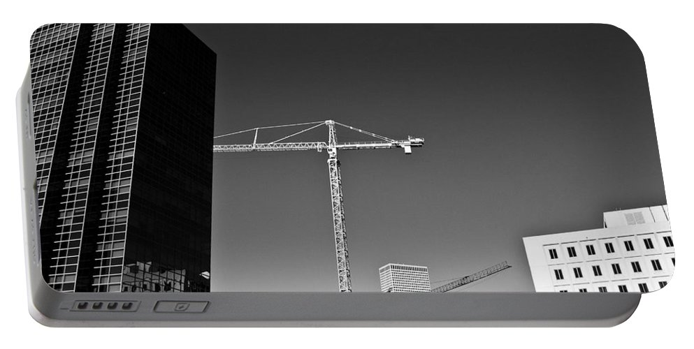 Buildings Portable Battery Charger featuring the photograph Cranes And Buildings Bw by Angus Hooper Iii
