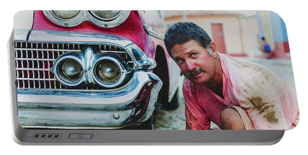 Potrait Portable Battery Charger featuring the photograph Cuban Mechanic by Blaz Gvajc