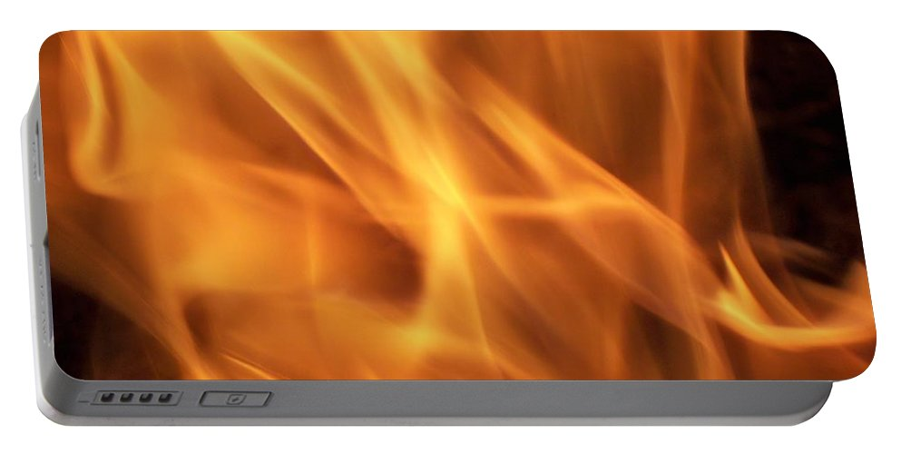 Fire Portable Battery Charger featuring the photograph Dancing With Fire by Betty Northcutt