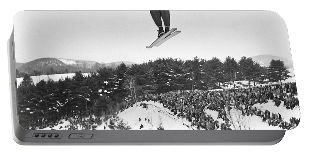 1950's Portable Battery Charger featuring the photograph Dartmouth Carnival Ski Jumper by Underwood Archives
