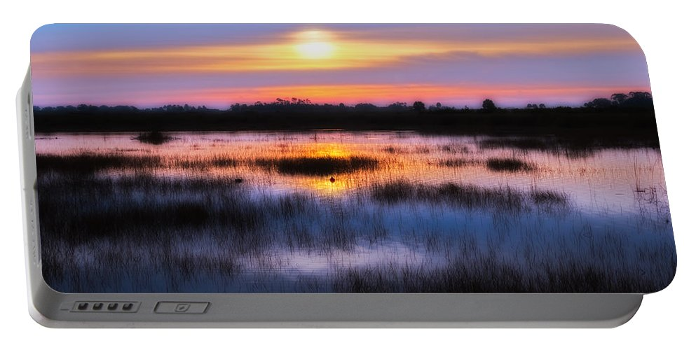 Sunrise Portable Battery Charger featuring the photograph Dawn Over The Salt Marsh by Rich Leighton