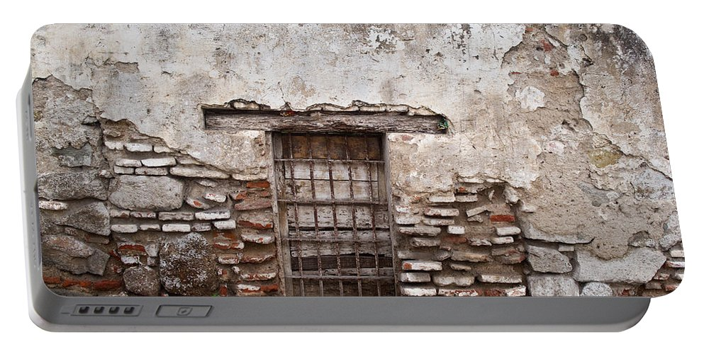 Decaying Portable Battery Charger featuring the photograph Decaying Wall And Window Antigua Guatemala by Douglas Barnett