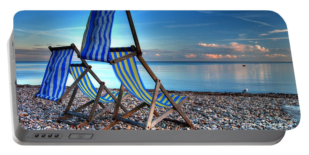 Deckchairs Portable Battery Charger featuring the photograph Deckchairs On The Shingle by Rob Hawkins