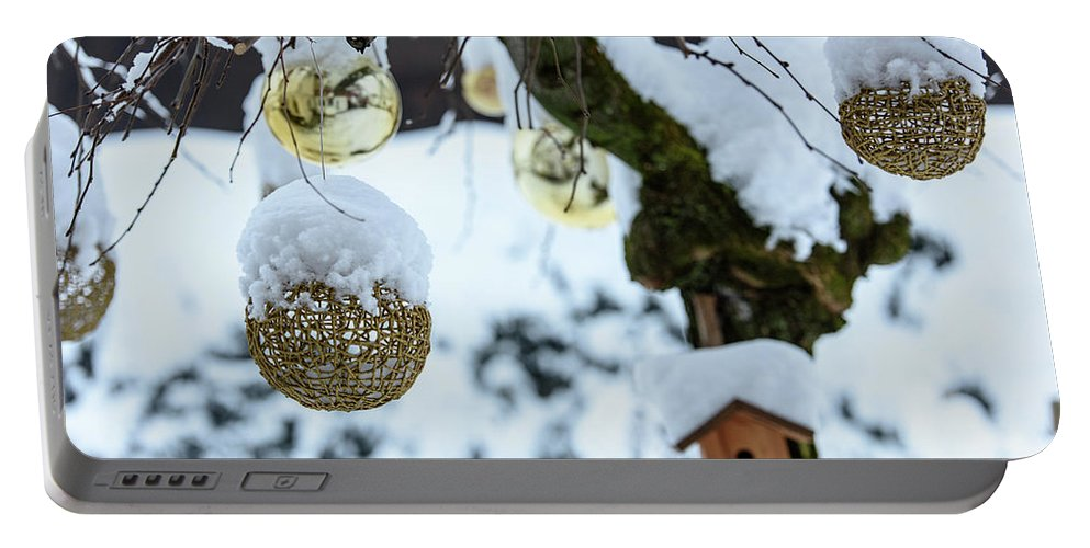 Snow Portable Battery Charger featuring the photograph Decorations In The Snow by Nicola Simeoni