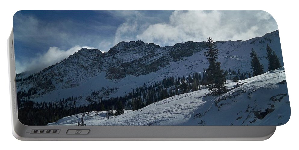 Ski Portable Battery Charger featuring the photograph Devils Castle Morning Light by Michael Cuozzo
