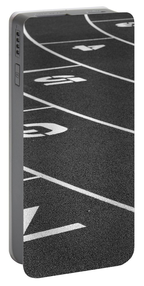 Track Portable Battery Charger featuring the photograph Dimensional Curve by Laddie Halupa