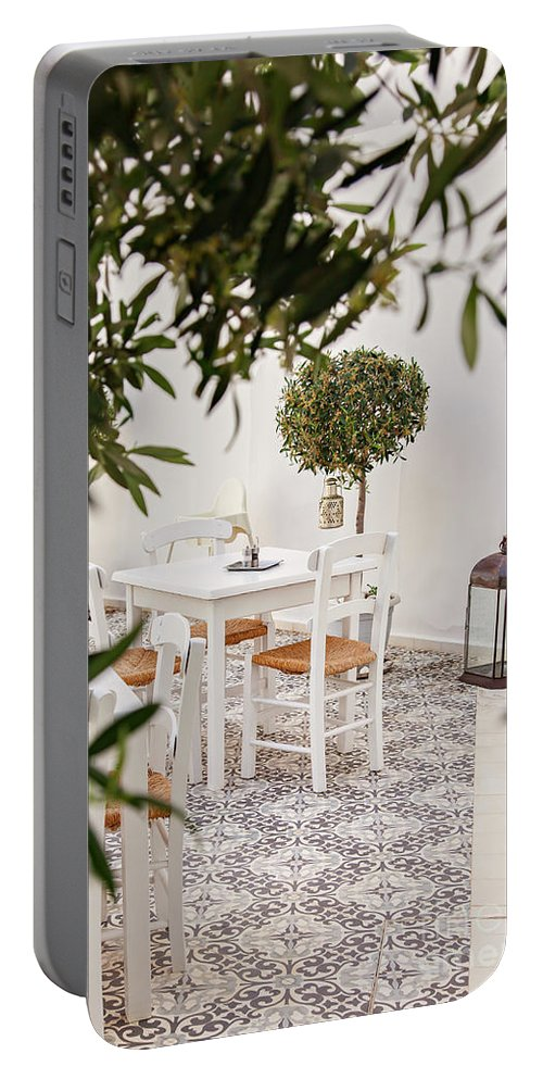 Courtyard Portable Battery Charger featuring the photograph Dining In The Courtyard by Sophie McAulay
