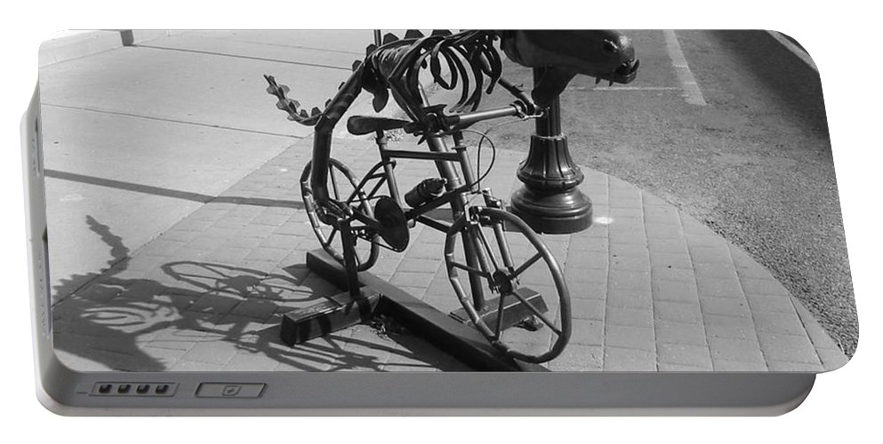Dinosaur Biking Portable Battery Charger featuring the photograph Dinosaur Biking Sculpture Grand Junction Co by Tommy Anderson
