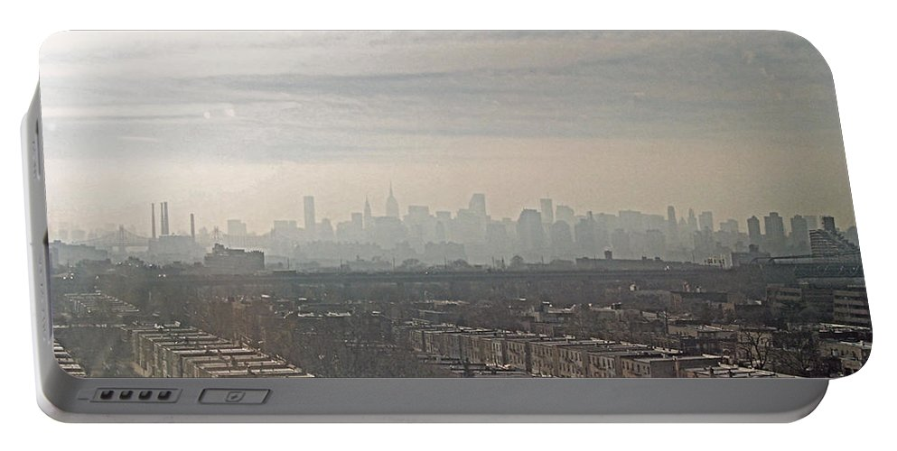 Brooklyn Portable Battery Charger featuring the photograph Distant City by Paulette B Wright