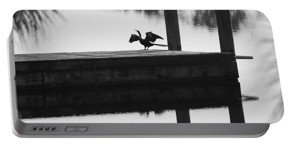 Black And White Portable Battery Charger featuring the photograph Dock Bird Pre Flight by Rob Hans