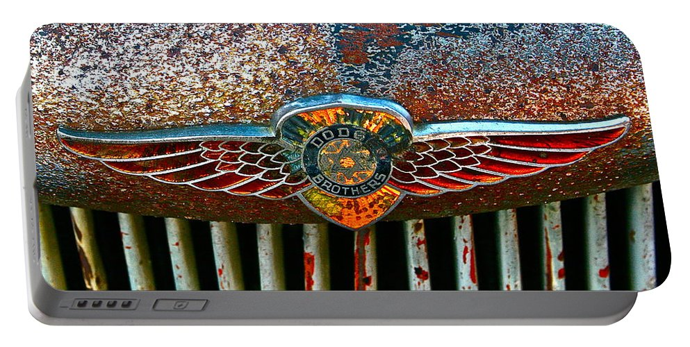 Dodge Emblem Portable Battery Charger featuring the photograph Dodge by Gwyn Newcombe