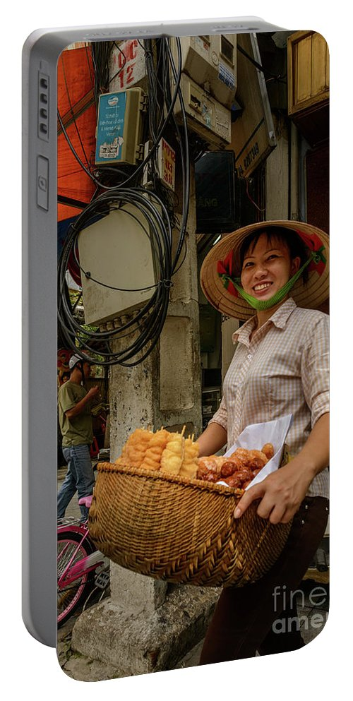 Asia Portable Battery Charger featuring the photograph Donut Seller by Werner Padarin