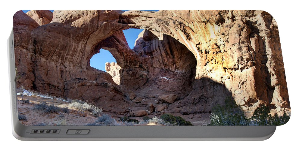 Sandstone Portable Battery Charger featuring the photograph Double Arch by Paul Cannon