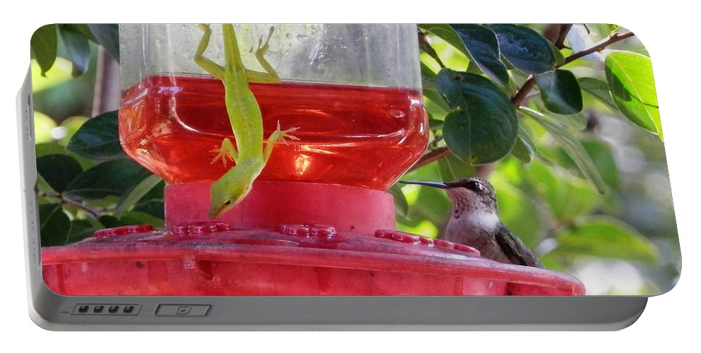 A #georgia #green #lizard And #baby #hummingbird Are Enjoying #sweet #nectar Together Portable Battery Charger featuring the photograph Double The Pleasure by Belinda Lee