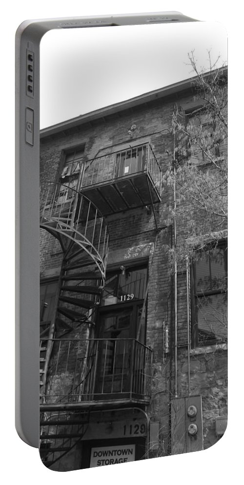 Black And White Photography Portable Battery Charger featuring the photograph Downtown Storage by Kirk Griffith