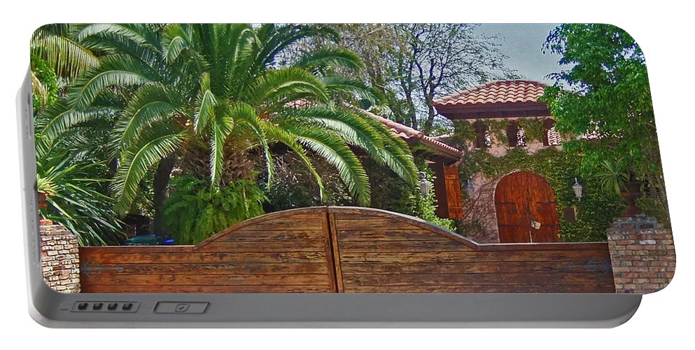Wooden Gates Portable Battery Charger featuring the photograph Dream Estate by Maria Keady