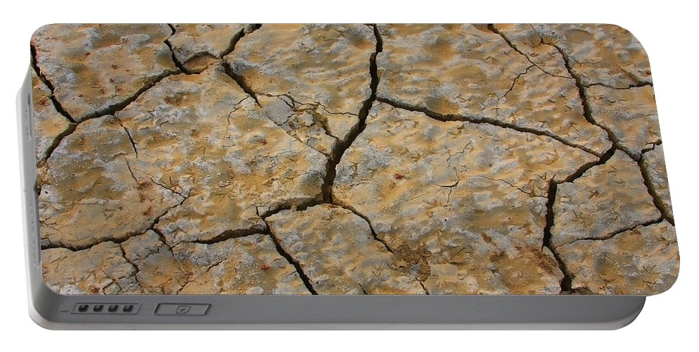 Cracks Portable Battery Charger featuring the photograph Dry Cracked Lake Bed by James BO Insogna