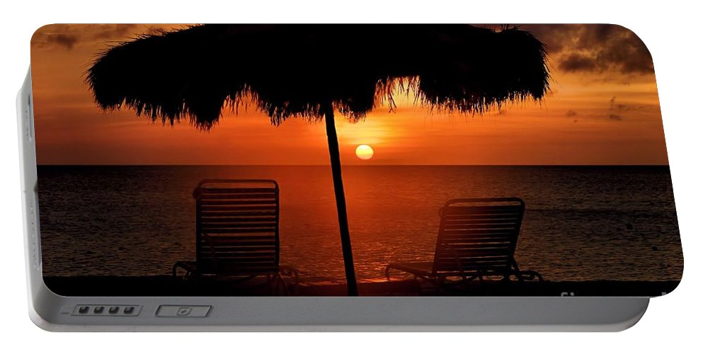 Sunset Portable Battery Charger featuring the photograph Eagle Beach Sunset by DJ Florek