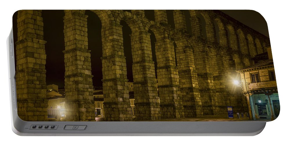 Joan Carroll Portable Battery Charger featuring the photograph Early Morning At The Aqueduct Of Segovia by Joan Carroll