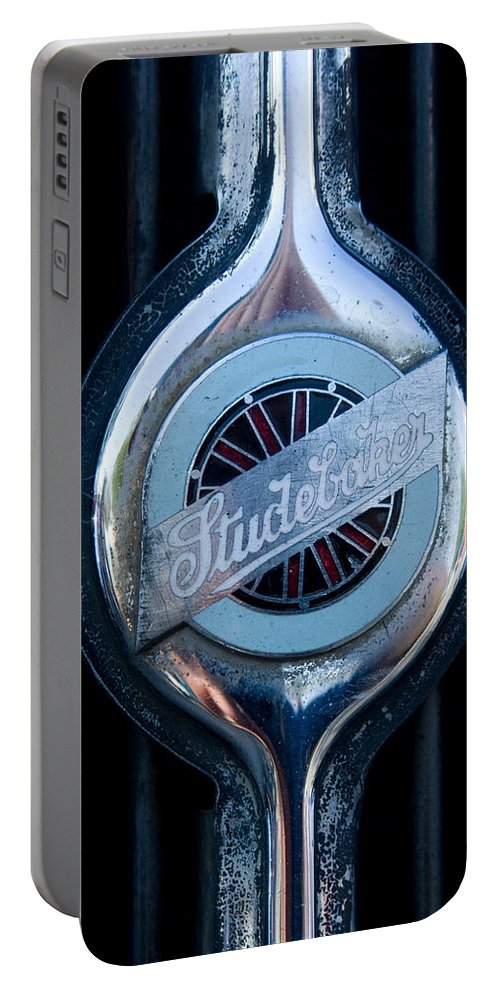 Early Studebaker Grill Emblem Portable Battery Charger featuring the photograph Early Studebaker Grill Emblem by Robert VanDerWal