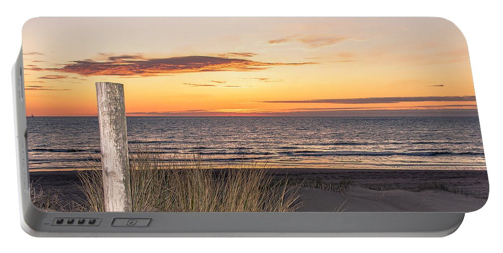 Sunset Portable Battery Charger featuring the photograph Easter Beach Light by Alex Hiemstra