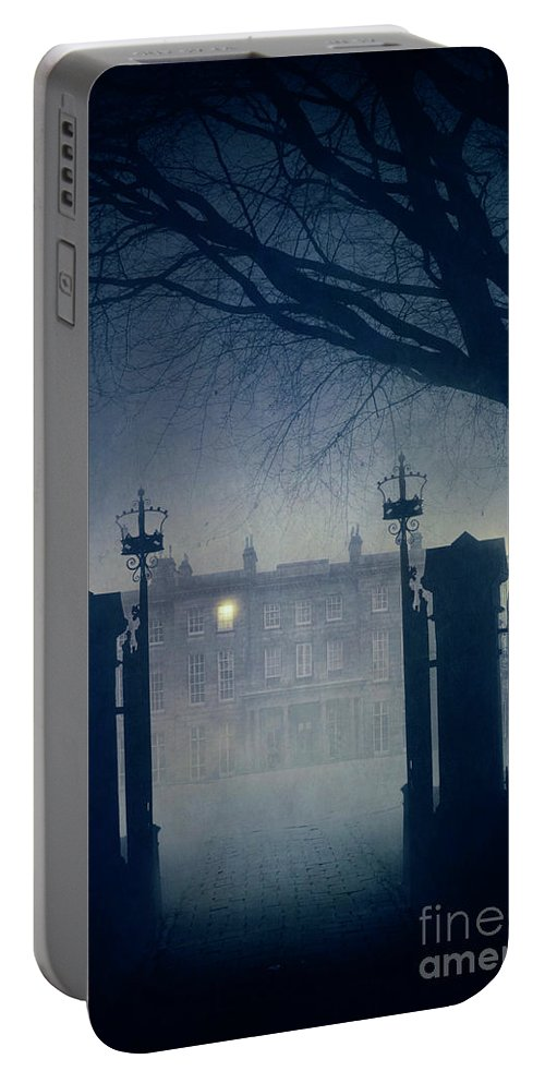 Mansion Portable Battery Charger featuring the photograph Eerie Mansion In Fog At Night by Lee Avison