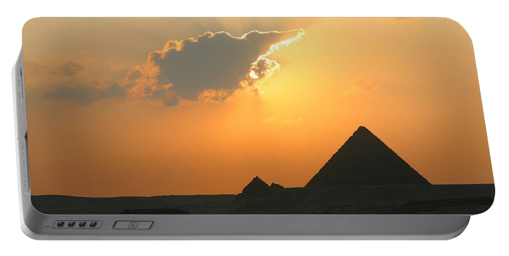 Pyramid Portable Battery Charger featuring the photograph Egpytian Sunset Behind Cloud by Donna Corless