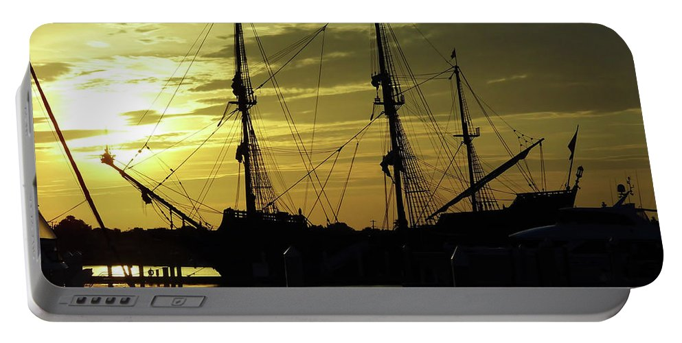 Sunrise Portable Battery Charger featuring the photograph El Galeon Sunrise by D Hackett