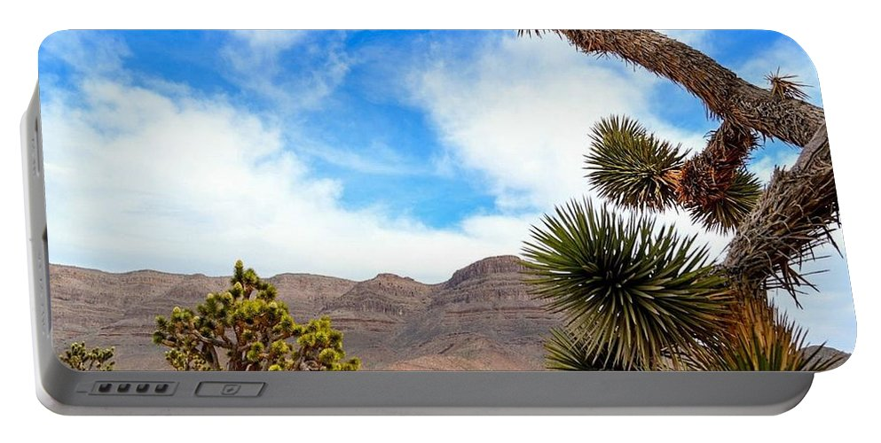 Sky Portable Battery Charger featuring the photograph En Route To Grand Canyon West Rim by Srinivasan Venkatarajan