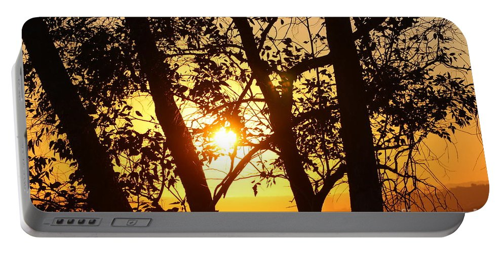 Sunset Portable Battery Charger featuring the photograph End Of The Day by Tommy Anderson