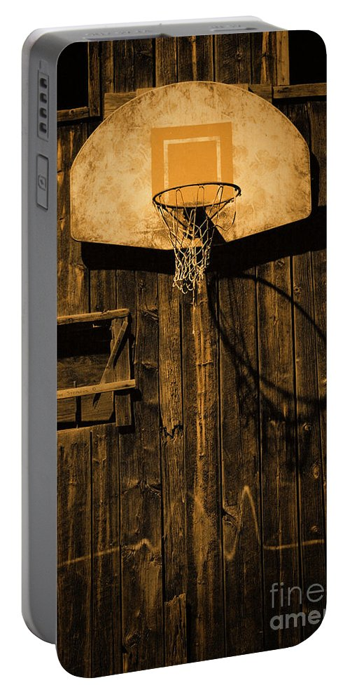 Basketball Portable Battery Charger featuring the photograph Enduring Echoes by John Stephens