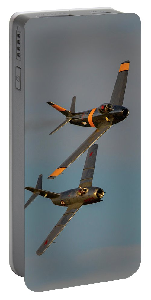 North American F-86 Sabre And Mikoyan-gurevich Mig-15 Portable Battery Charger featuring the photograph F-86 And Mig-15 by Tommy Anderson