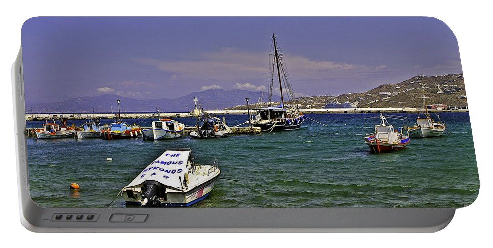 Mykonos Portable Battery Charger featuring the photograph Famous Mykonos Bar by Madeline Ellis