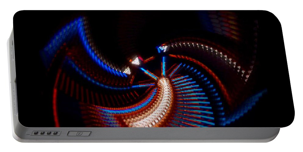 Chaos Portable Battery Charger featuring the photograph Fan Dance by Charles Stuart