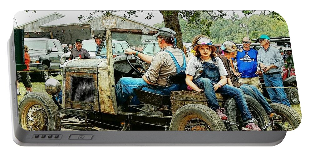Wmstr Portable Battery Charger featuring the photograph Father And Daughter In The Tractor Parade by Curtis Tilleraas