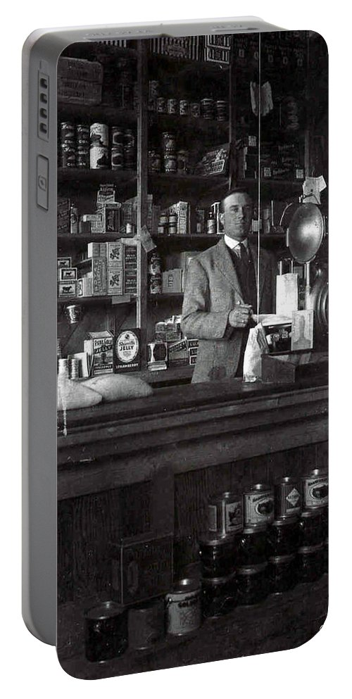 Old General Store Early Years 1900s Country Town Food Goods Grocery Black And White Photograph Portable Battery Charger featuring the photograph Fine Old Store by Andrea Lawrence