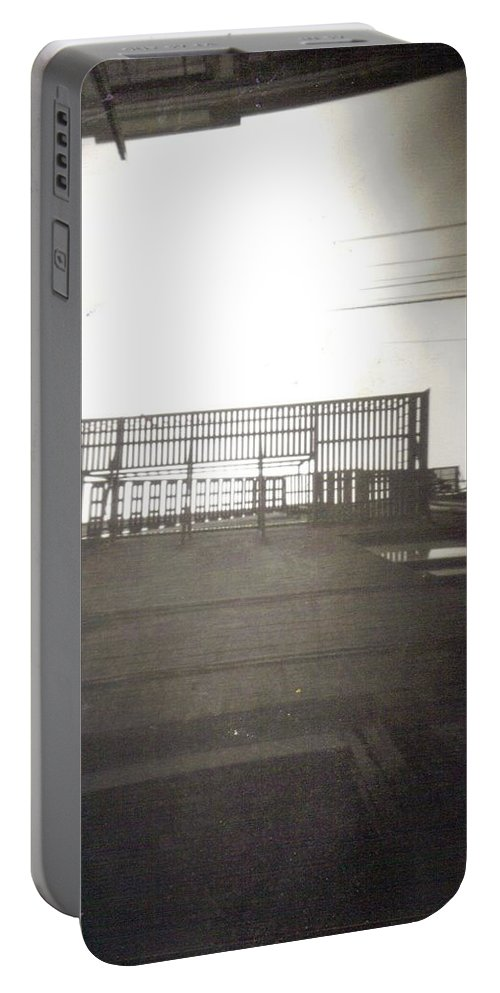 Black And White Photograph Portable Battery Charger featuring the photograph Fire Escape by Thomas Valentine