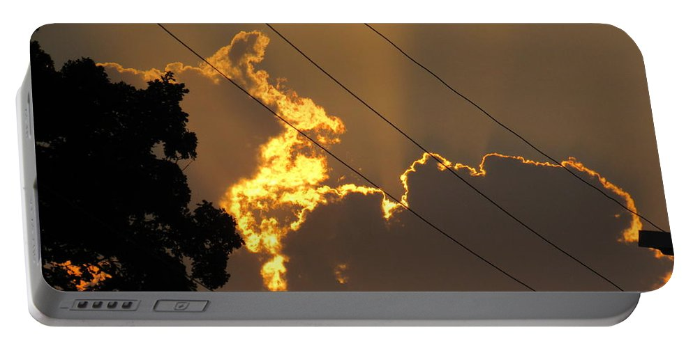 Fire In The Sky Portable Battery Charger featuring the photograph Fire In The Sky by Esther Race