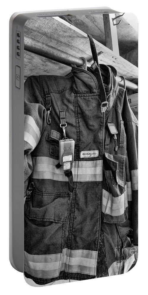 Fireman Portable Battery Charger featuring the photograph Fireman - Saftey Jacket Black And White by Paul Ward