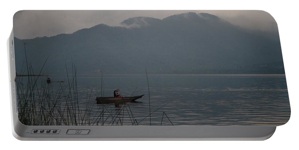 Lone Portable Battery Charger featuring the photograph Fisherman Baiting Line Lake Atitlan Guatemala by Douglas Barnett