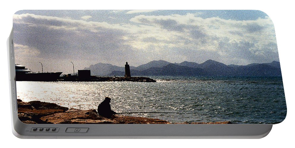 Fisherman Portable Battery Charger featuring the photograph Fisherman In Nice France by Nancy Mueller