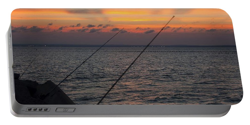 Fishing Portable Battery Charger featuring the photograph Fishing At Sunset by Steven Natanson