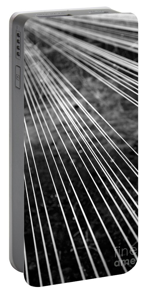 Abstract Portable Battery Charger featuring the photograph Fishing Lines by Gaspar Avila