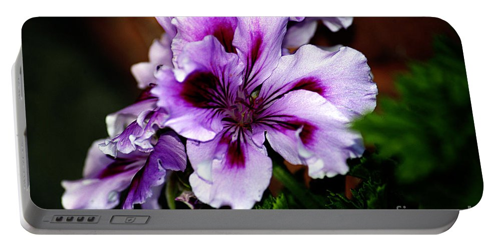 Clay Portable Battery Charger featuring the photograph Florals by Clayton Bruster