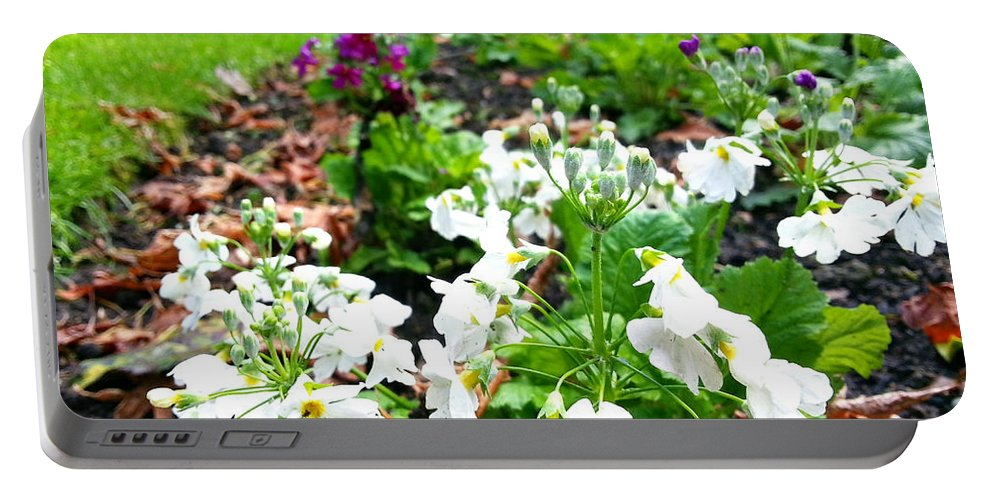 Flowers Portable Battery Charger featuring the photograph Flower Bed by Wayne Henry