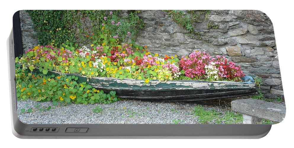 Inistioge Portable Battery Charger featuring the photograph Flowers Floating by Kelly Mezzapelle