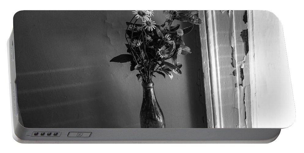 Flowers Portable Battery Charger featuring the photograph Flowers In A Peculiar Vase by Taylor McLaurin