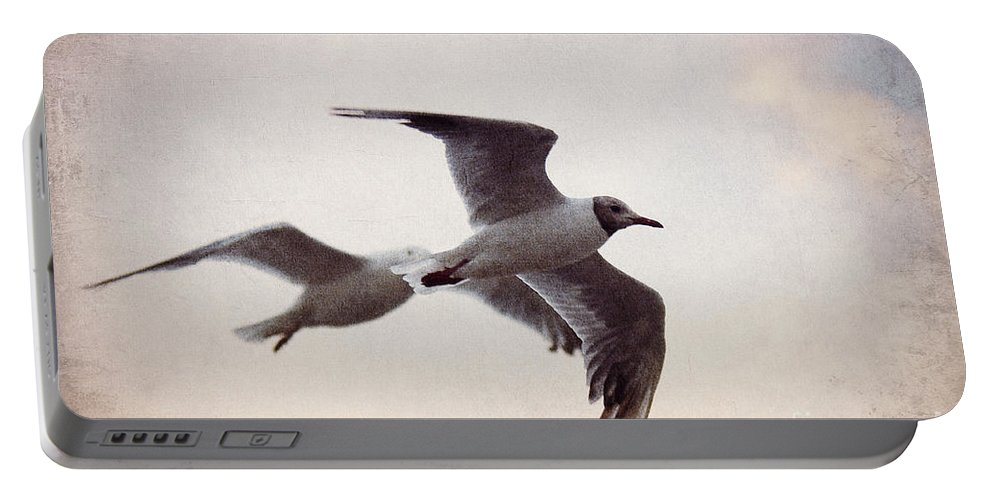 Gull Portable Battery Charger featuring the photograph Flying by Angela Doelling AD DESIGN Photo and PhotoArt