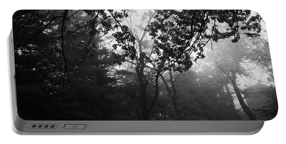 Monochrome Portable Battery Charger featuring the photograph Fog In The Trees by Frank J Casella