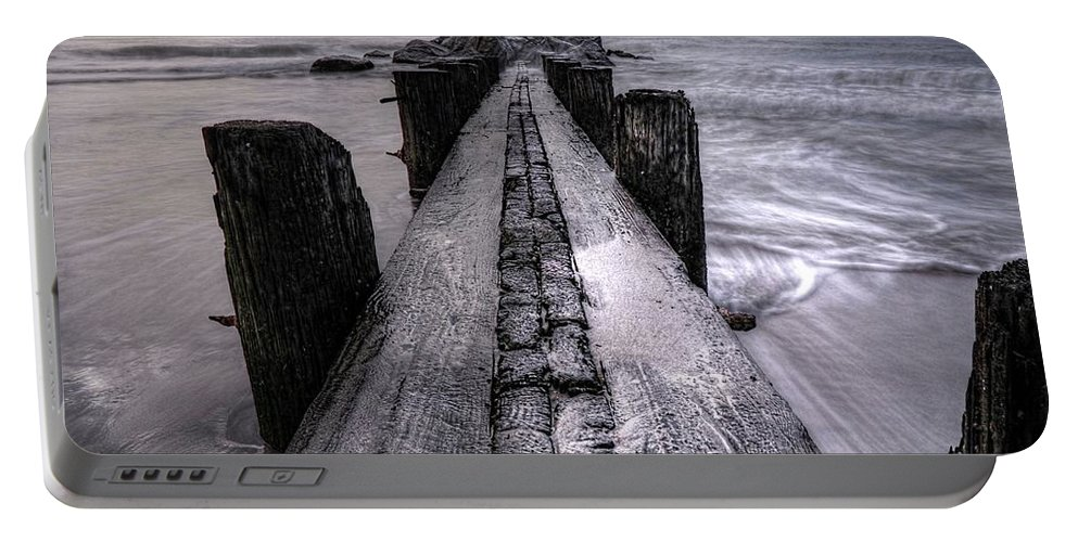 Folly Beach Pilings Portable Battery Charger featuring the photograph Folly Beach Pilings Charleston South Carolina by Carol Montoya